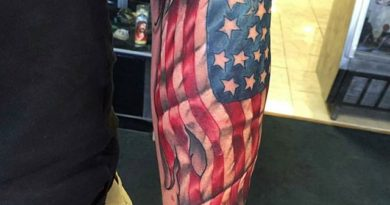 Veteran Flag Forearm Tattoo