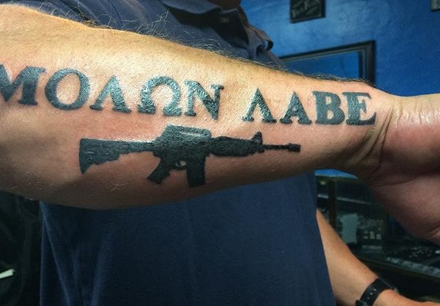 molon labe forearm tattoo veteran ink