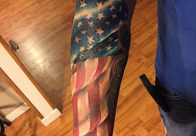 Colored American Flag Forearm Tatttoo