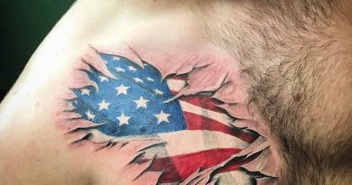 American Flag Tear Through Chest Tattoo